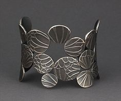 Cuff | Maria Samora (Taos Pueblo, New Mexico).  Sterling silver with dark patina.
