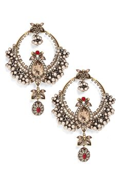 Designed to bring the drama, these intricately crafted statement earrings feature glittering crystals, textural clusters of spheres and subtle skull embellishments.