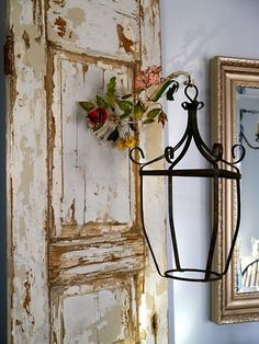 old chipped paint door w/lantern on hook.... I love this in place of a set of drapes against a big window