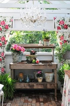 Garden potting bench with chandelier....I need a chandelier above my potting bench!
