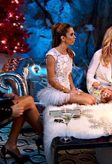 Lydia McLaughlin's White Lace and Feather Dress DETAILS: http://www.bigblondehair.com/real-housewives/rhoc/lydia-mclaughlins-white-feather-dress-at-vickis-party/