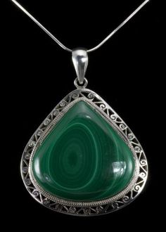 "Malachite Sterling Pendant Teardrop shape Malachite stone set in sterling silver. Pendant is 2-1/2""""L x 1-3/4""""W including bail. Chain not included.  http://www.sterlingjewelrystores.com/sterling-silver-Malachite-Sterling-Pendant.html"