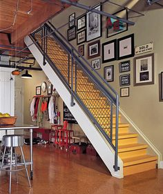 A modern loft staircase with a makeshift mudroom below