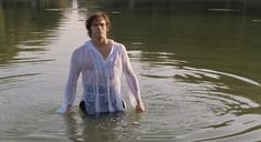 Mr Darcy emerging from the basin of a water fountain (Lost in Austen).
