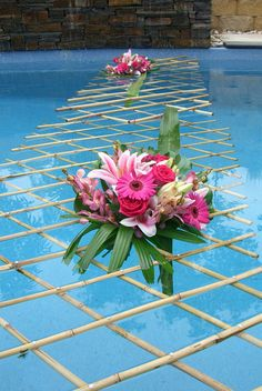 Check out the Bamboo Lattice holding up these florals across the water! Such simple and great use of the water structure to add to the event decor!