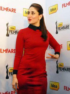 Kareena Kapoor: Kareena is wearing a red sheath dress with black collar and sleeves.Kareena looks ravishing in a red sari. Check out here