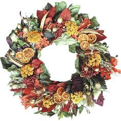 Welcome guests to your home in natural style with this lovely wreath, featuring a collection of preserved flowers and citrus slices.