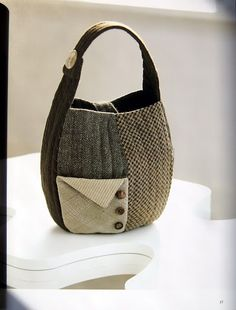 Recycled Fabrics, side fastener on handle, various tweeds and sweater front pocket decorated with buttons.