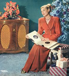 Love her robe. There's nothing like listening to your favourite Christmas tunes on record.