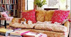 English rolled arm sofa from Restoration Hardware covered in lovely floral fabric and balanced with similar colors in the rest of this pretty living room.