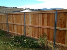 These steel posts are engineered to provide you with the strength of steel without sacrificing the natural beauty of wood. Constructed of structural steel with a heavy galvanized coating, Postmaster . Diy Fence, Backyard Fences, Fence Ideas, Yard Ideas, Good Neighbor Fence, Wood Fence Design, Fencing Companies, Fence Styles, Privacy Fences