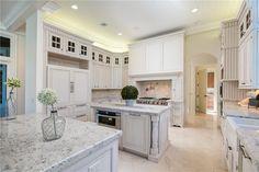 Traditional Kitchen with Flush, Farmhouse Sink, U-shaped, Kitchen island, MS International SF Real Granite, Stone Tile