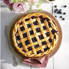 Honey-Balsamic-Blueberry Pie | Unexpected but oh-so right, a touch of tangy-sweet balsamic vinegar combined with honey, cinnamon, and a pinch of freshly ground black pepper magnifies the sweetness of blueberries. We love this buttery crust, but if time is short, substitute a store-bought one   and simply crimp the edges. | SouthernLiving.com