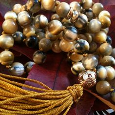 Fall celebrating japamala in gold tiger eye