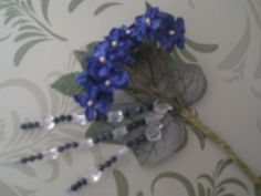 Simple blue silk flowers with blue and white crystal bead stems  - button hole