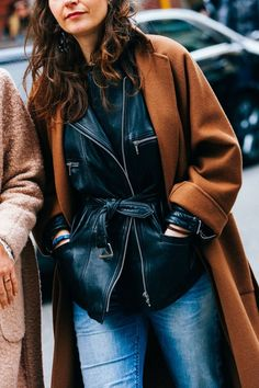 A camel overcoat worn over a leather jacket | Image via vogue.fr