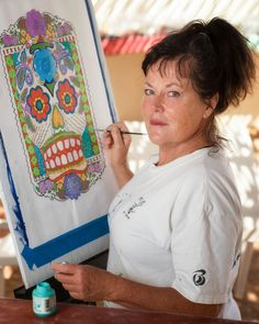 """jarrardphotography posted a photo:  I met Nicole on a beach in Baja California South, Mexico. She was painting some of her artwork and I stopped to admire her work.  I asked if she wouldn't mind being one of my 100 strangers and she was quite happy to accept.  I asked Nicole to describe herself as I set up my 24 inch portable soft box and nikon SB-900 flash. I got Nicole to move a few feet over to the shade.  """"I'm an adventurous person and I love the ocean. I planned for years to come down…"""