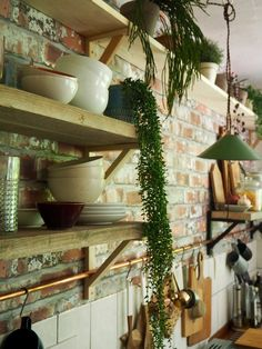 The copper pipe running through the shelf brackets forming a rail…. Sage Green Kitchen, Copper Kitchen, Kitchen White, Copper Shelf Brackets, Copper Pipe Shelves, Brick Effect Wallpaper, Brick Wallpaper Kitchen, Cheap Kitchen Makeover, Kitchen Shelves