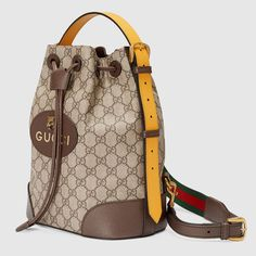 Shop the GG Supreme backpack by Gucci. A drawstring backpack with a bucket shape made in soft GG Supreme, crafted from a coated microfiber fabric. The back shoulder straps come with a mechanism that allows them to be released and adjusted to be worn as a shoulder strap. The contrast handle pays homage to the House's past, when artisans would repair luggage by replacing worn handles with new ones in any colors that were available.