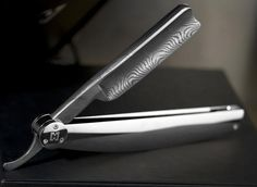 I think I like the smoothness of this and the end of the scales is interesting. However, this is encroaching on looking like a pocket knife. I also like the contrast between the brushed titanium look and the mirror finish (assuming I am seeing this correctly). Not a fan of the damascus. straight razor platinum