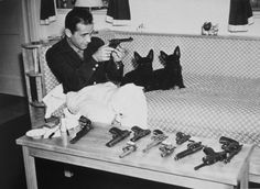 Humphrey Bogart. You can never have enough guns or scotty dogs. ;-)