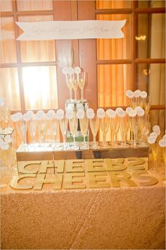 cheers drink table with escort cards on each glass.   @LVL Events , @Artisan Events , @kameejunephotography, @Miramonte Resort