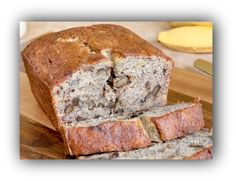 7440111-sliced-loaf-of-walnut-banana-bread-with-bananas-and-milk-in-the-background
