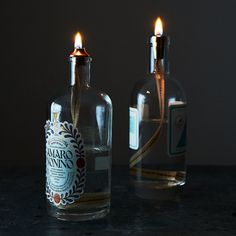 "Turn Empty Liquor Bottles Into Beautiful Oil Lamps. That said, ""empty liquor bottles"" is not a common problem in my house. Empty Liquor Bottles, Alcohol Bottles, Old Bottles, Liquor Bottle Lights, Bottle Lamps, Oil Light, Oil Lamps, Clever Diy, Candle Making"