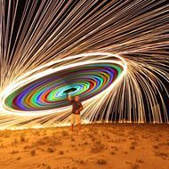 """Shot this 3 second """"selfie"""" tonight at Coronado Beach, CA. This is me swinging a string of glow sticks with burning steel wool at the end. Canon 5D SR, Canon 16-35mm @16mm. F2.8, ISO 800. 3 second exposure. The best part of this shot was the audience reaction. There were a bunch of kids on the beach, and their """"oohs and ahhs"""" made me think of firework shows when I was a kid."""