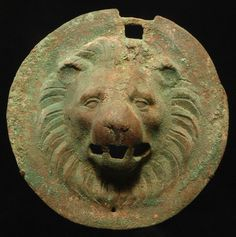 Roman Bronze Lion Head Roundel. This and more ancient art for sale on the CuratorsEye.com