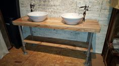 Custom-made double vanity handcrafted of ambrosia maple. The galvanized pipe base gives it an industrial look.
