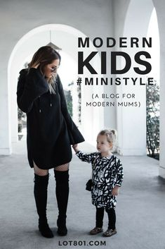 Baby & Toddler gender neutral graffiti pullover / sweater dress is perfect for mini street style. Mom wearing thigh high black boots and black smock / dress. Love this mother daughter look for pictures. This blog has the best outfit ideas for the littles.