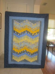 Sunshine and Flowers -- a blue/yellow bargello quilt.
