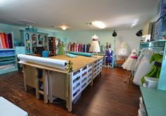 House of Turquoise: Marg Hyland Dressmaking Studio for Pegeen ~ custom flower girl dresses and ring bearer suits ~ The cutting island is 4 Ikea Varde drawer units placed together with a top ~ giant roll of paper for patternmaking or cutting slippery fabrics ~