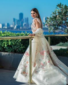 An Ivory bridal dream drenched in glimmer & sorbet-hued blooms! Indian Wedding Gowns, Indian Bridal Outfits, Indian Fashion Dresses, Indian Designer Outfits, Wedding Lehenga Designs, Designer Sarees Wedding, Wedding Dresses For Girls, Bridal Dresses, Prom Dresses