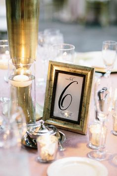 Gold + black frame table numbers | Photography: I Love You Too Weddings - www.iloveyoutooweddings.com  Read More: http://www.stylemepretty.com/2014/06/02/modern-art-museum-wedding/