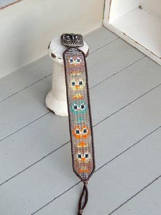 Cute fall owl loom woven cuff friendship bracelet    This bracelet is hand woven in a cute little owl pattern, the perfect quirky and fun cuff