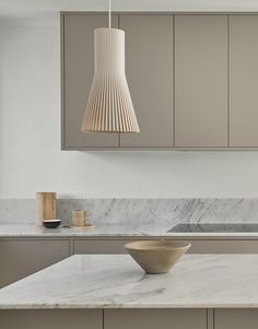 Grey minimalist kitchen from Nordiska Kök. A bespoke, modern kitchen for Scandinavian living. Countertop in white marble and appliances from Gaggenau. See the latest kitchen inspiration, design and trends at www.