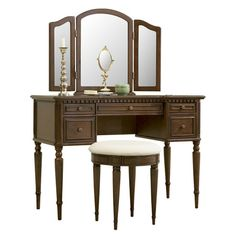 5-drawer wood vanity with a tri-fold mirror and stool with turned spindle legs.  Product: Vanity, mirror and stoolConstr...