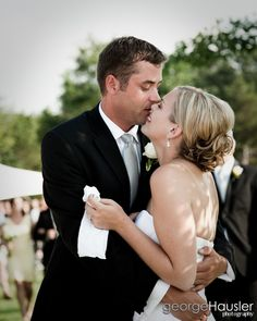 The bride overcome with joy in the arms of her man, the groom! Romantic love filled with emotion!