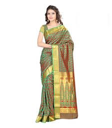Showcase pure traditional elegance at the next gala wearing this gorgeous Green coloured saree. This art silk saree is best go with stilettos and a sleek clutch.