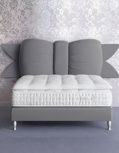 "Chantal Thomas Bow Bed.  This is so adorable, I can't contain myself.  The gray does a great job by not ""over-girlifying"" the headboard, versus a pink. It's like a demure feminine touch."