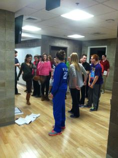 Some members of Shrek the Musical rehearsing in a hallway of the Sci/Tech Building.