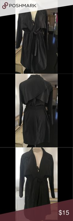 ATMOSPHERE UK MICRO SUEDE TRENCH COAT US SZ 10 Pre owned, gently worn and in excellent condition. Color is a charcoal black. SZ is IS 10. Micro suede polyester/blend. Belted, wrap front, two deep pockets. No rips, stains or odors. Smoke free environment. Atmosphere Jackets & Coats Trench Coats