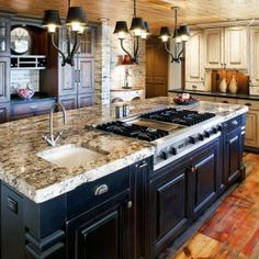 Colorado Rustic Kitchen Design with black and white distressed  painted wood, center island stove and sink.