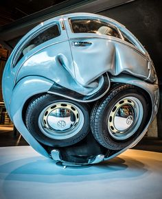 VW Cars Compressed into Perfect Spheres and Cubes by Ichwan Noor