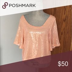 """Free people night fever peach top Gorgeous sequin top with a low back. NWT, a few sequins missing from the shoulder as shown in pictures. Length is approx 22"""" and armpit to armpit measures approx 20"""" 💛💛💛ALL ITEMS come from a smoke free, meow friendly home💛💛💛 Free People Tops"""