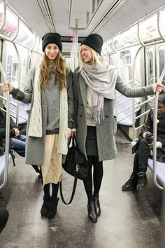 Shop this look on Lookastic: https://lookastic.com/women/looks/shawl-coat-crew-neck-sweater-mini-skirt-ankle-boots-tote-bag-beanie-tights/6393 — Black Beanie — Beige Crew-neck Sweater — Grey Coat — Charcoal Mini Skirt — Black Leather Tote Bag — Black Wool Tights — Black Leather Ankle Boots — Grey Shawl
