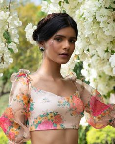 Featuring a multi-color floral print ruffle top with balloon sleeves in organza and shantoon base and comes with a tie-up knot at the back. Crop Top Designs, Fancy Blouse Designs, Saree Blouse Neck Designs, Saree Blouse Patterns, Stylish Blouse Design, Organza, Crop Tops, Women's Tops, Sexy
