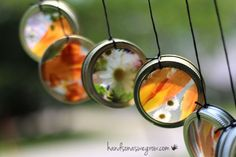 Stunning suncatcher wind chimes the kids can make that was inspired by our fun tin can wind chimes, mixed with our nature suncatchers.